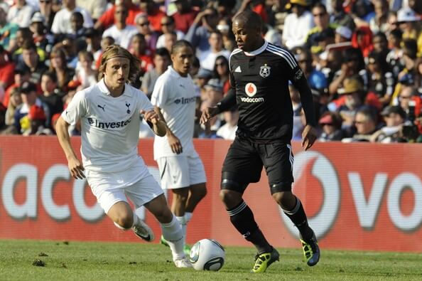 Andile Jali of Pirates and Luka Modric of Tottenham compete during the 2011 Vodacom Challenge final match between Orlando Pirates and Tottenham Hotspur at Coca Cola Stadium on July 23, 2011 in Johannesburg, South Africa.  (July 22, 2011 - Source: Gallo Images/Getty Images Europe)