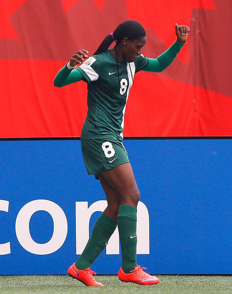 Asisat Oshoala #8 of Nigeria reacts after scoring the second goal against Sweden during the FIFA Women's World Cup Canada 2015 Group D match between Sweden and Nigeria at Winnipeg Stadium on June 8, 2015 in Winnipeg, Canada.  (June 7, 2015 - Source: Kevin C. Cox/Getty Images North America)