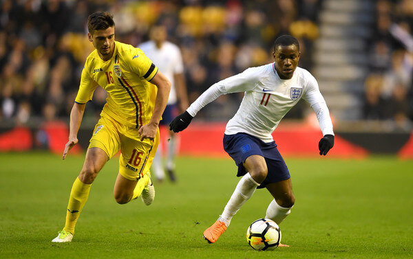 Ademola Lookman of England gets past Dragos Nedelcu of Romania during the International Friendly between England U21 and Romania U21 at Molineux on March 24, 2018 in Wolverhampton, England.  (March 23, 2018 - Source: Gareth Copley/Getty Images Europe)