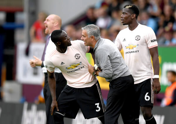 Jose Mourinho, Manager of Manchester United in discussion with Eric Bailly of Manchester United as he replaces Paul Pogba of Manchester United during the Premier League match between Burnley FC and Manchester United at Turf Moor on September 2, 2018 in Burnley, United Kingdom.  (Sept. 1, 2018 - Source: Shaun Botterill/Getty Images Europe)