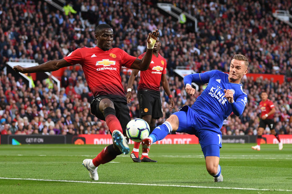 Eric Bailly of Manchester United and James Maddison of Leicester City battle for possession during the Premier League match between Manchester United and Leicester City at Old Trafford on August 10, 2018 in Manchester, United Kingdom.  (Aug. 9, 2018 - Source: Michael Regan/Getty Images Europe)