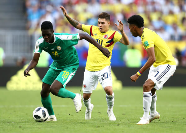 Ismaila Sarr of Senegal and Juan Quintero of Colombia in action during the 2018 FIFA World Cup Russia group H match between Senegal and Colombia at Samara Arena on June 28, 2018 in Samara, Russia.  (June 27, 2018 - Source: Maddie Meyer/Getty Images Europe)