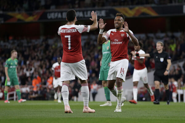 Pierre-Emerick Aubameyang of Arsenal celebrates after scoring his team's third goal with Henrikh Mkhitaryan of Arsenal during the UEFA Europa League Group E match between Arsenal and Vorskla Poltava at Emirates Stadium on September 20, 2018 in London, United Kingdom.  (Sept. 19, 2018 - Source: Henry Browne/Getty Images Europe)