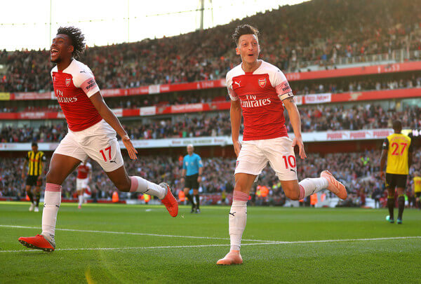 Mesut Ozil of Arsenal (r) celebrates scoring his sides second goal with Alex Iwobi during the Premier League match between Arsenal FC and Watford FC at Emirates Stadium on September 29, 2018 in London, United Kingdom.  (Sept. 28, 2018 - Source: Catherine Ivill/Getty Images Europe