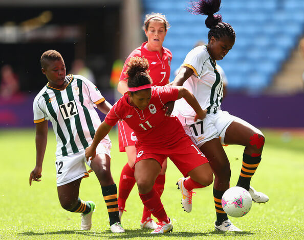 Desiree Scott of Canada and Andisiwe Mgcoyi of South Africa contest for the ball during the Women's Football first round Group F Match of the London 2012 Olympic Games between Canada and South Africa, at City of Coventry Stadium on July 28, 2012 in Coventry, England.  (July 27, 2012 - Source: Quinn Rooney/Getty Images Europe)