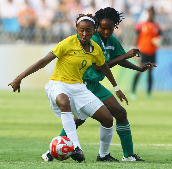 Ester of Brazil holds off Perpetua Nkwocha of Nigeria during the Women's First Round Group F match between Nigeria and Brazil at the Workers' Stadium on Day 4 of the Beijing 2008 Olympic Games on August 12, 2008 in Beijing, China.  (Aug. 11, 2008 - Source: Jeff Gross/Getty Images AsiaPac)