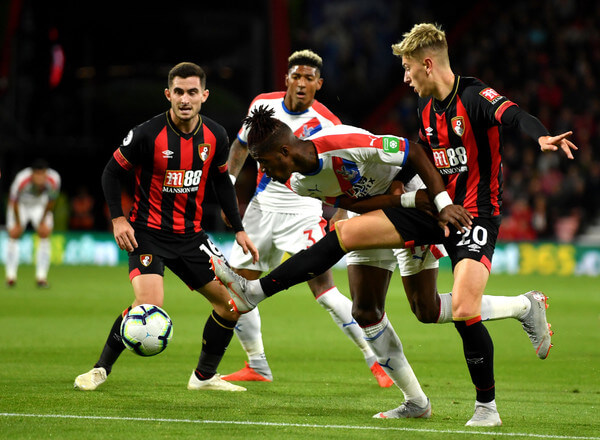 Wilfried Zaha of Crystal Palace battles for possession with David Brooks of AFC Bournemouth during the Premier League match between AFC Bournemouth and Crystal Palace at Vitality Stadium on October 1, 2018 in Bournemouth, United Kingdom.  (Sept. 30, 2018 - Source: Mike Hewitt/Getty Images Europe)