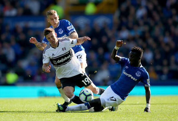 Idrissa Gueye of Everton slides in to tackle Luciano Vietto of Fulham as Lucas Digne of Everton looks on during the Premier League match between Everton FC and Fulham FC at Goodison Park on September 29, 2018 in Liverpool, United Kingdom.  (Sept. 28, 2018 - Source: Alex Livesey/Getty Images Europe)
