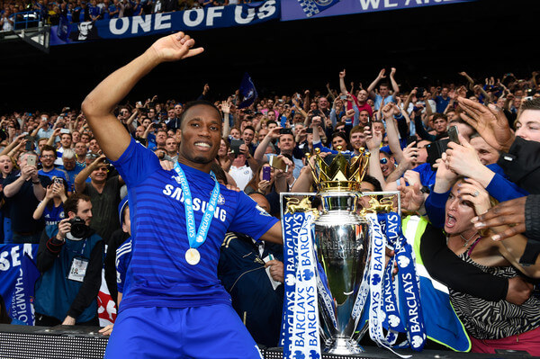 Didier Drogba of Chelsea celebrates with fans and the trophy after the Barclays Premier League match between Chelsea and Sunderland at Stamford Bridge on May 24, 2015 in London, England. Chelsea were crowned Premier League champions.  (May 24, 2015 - Source: Mike Hewitt Premier League/Getty Images Europe)