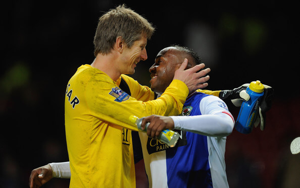 Edwin van der Sar of Manchester United shares a laugh with Benni McCarthy of Blackburn after the Barclays Premier League match between Manchester United and Blackburn Rovers at Old Trafford on October 31, 2009 in Manchester, England.  (Oct. 30, 2009 - Source: Michael Regan/Getty Images Europe)