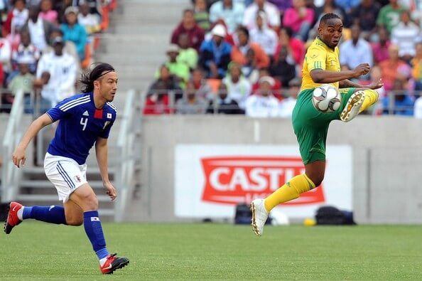 Benni McCarthy and Tanaka Marcus in action durng the International friendly match between South Africa and Japan at Nelson Mandela Bay Stadium on November 14, 2009 in Port Elizabeth, South Africa.  (Nov. 13, 2009 - Source: Gallo Images/Getty Images Europe)