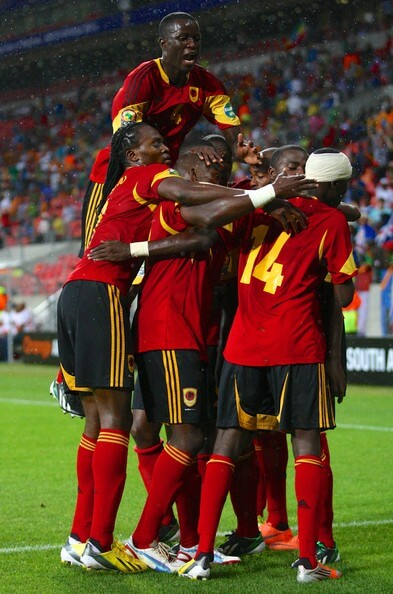 Angola players celebrate their first goal during the 2013 Orange African Cup of Nations match between Cape Verde Islands and Angola from Nelson Mandela Bay Stadium on January 27, 2013 in Port Elizabeth, South Africa.  (Jan. 26, 2013 - Source: Gallo Images/Getty Images Europe)