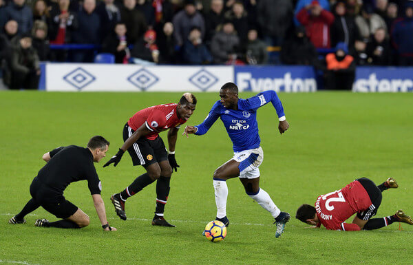 Yannick Bolasie of Everton on the ball as referee Andre Marriner takes a tumble during the Premier League match between Everton and Manchester United at Goodison Park on January 1, 2018 in Liverpool, England.  (Dec. 31, 2017 - Source: Tony McArdle - Everton FC/Everton FC)