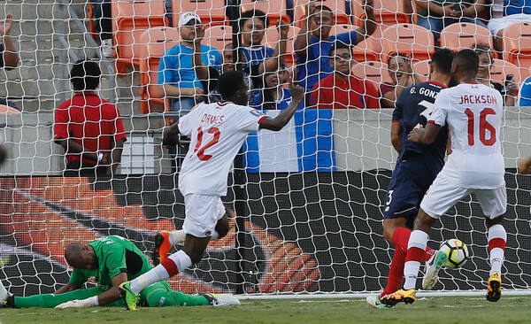 Patrick Pemberton #18 of Costa Rica is beaten by Alphonso Davies #12 of Canada for a goal in the in the first half at BBVA Compass Stadium on July 11, 2017 in Houston, Texas.  (July 10, 2017 - Source: Bob Levey/Getty Images North America)