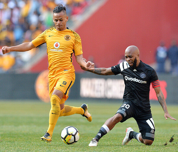 Gustavo Paez and Oupa Manyisa during the Carling Black Label Champion Cup match between Orlando Pirates and Kaizer Chiefs at FNB Stadium on July 29, 2017 in Johannesburg, South Africa. At least two people have been reported to have been killed and several injured in a crush during the game at South Africa's biggest stadium.  (July 28, 2017 - Source: Gallo Images/Getty Images Europe)