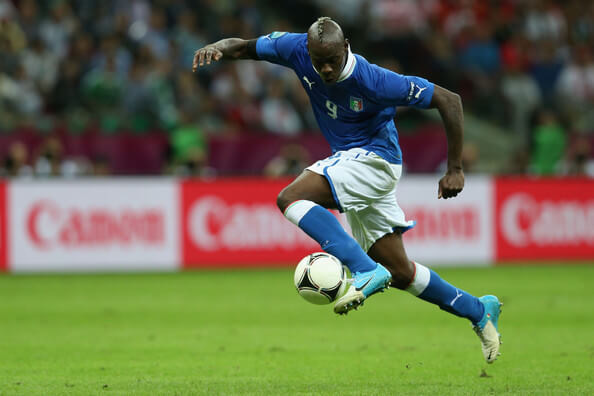 Mario Balotelli of Italy controls the ball as he runs through to score his team's second goal during the UEFA EURO 2012 semi final match between Germany and Italy at the National Stadium on June 28, 2012 in Warsaw, Poland.  (June 27, 2012 - Source: Joern Pollex/Getty Images Europe)