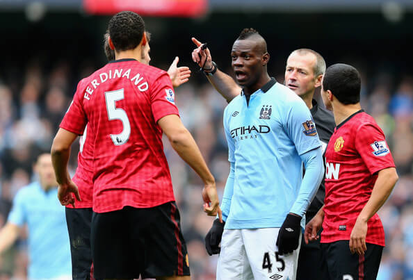 Rio Ferdinand of Manchester United and Mario Balotelli of Manchester City have words during the Barclays Premier League match between Manchester City and Manchester United at the Etihad Stadium on December 9, 2012 in Manchester, England.  (Dec. 8, 2012 - Source: Clive Mason/Getty Images Europe)