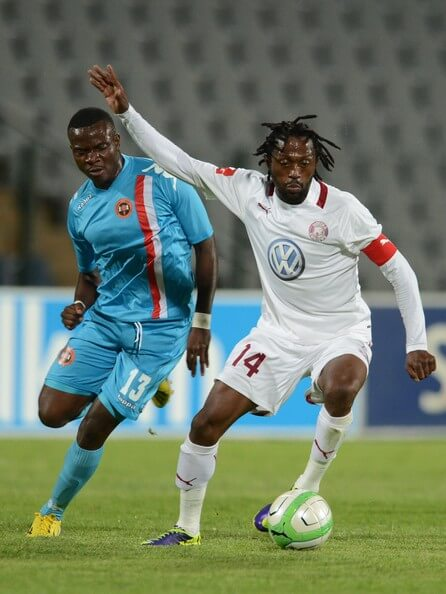 Galabgwe Moyana of Polokwane City and Lerato Chabangu (R) of Moroka Swallows during the Absa Premiership match between Moroka Swallows and Polokwane City at Dobsonville Stadium on December 18, 2013 in Dobsonville, South Africa.  (Dec. 17, 2013 - Source: Gallo Images/Getty Images Europe)