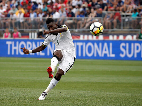 Asamoah Gyan #3 of Ghana scores a goal against the United States defends in the second half during an international friendly between USA and Ghana at Pratt & Whitney Stadium on July 1, 2017 in East Hartford, Connecticut.  (June 30, 2017 - Source: Jim Rogash/Getty Images North America)