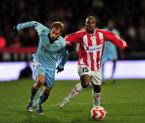 Pablo Zabaleta.of Manchester City is challenged by Siyabonga Nomvethe of Aalborg during the UEFA Cup, Round of 16, Second Leg match between Aalborg and Manchester City on March 19, 2009 in Aalborg, Denmark.  (March 19, 2009 - Source: Stuart Franklin/Getty Images Europe)
