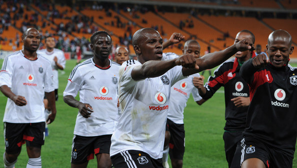 Khethowakhe Masuku celebrating his goal with team mates during the CAF Confedaration Cup match between Orlando Pirates and Zanaco at FNB Stadium on April 06, 2013 in Johannesburg, South Africa.  (April 5, 2013 - Source: Gallo Images/Getty Images Europe)