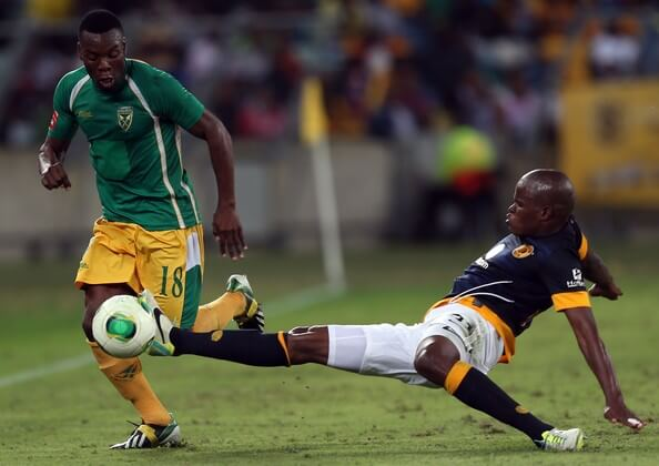 Wiyanda Zwane of Lamontville Golden Arrows is tackled by Willard Katsande (R) of Kaizer Chiefs during the Absa Premiership match between Golden Arrows and Kaizer Chiefs at Moses Mabhida Stadium on December 19, 2013 in Durban, South Africa.  (Dec. 18, 2013 - Source: Gallo Images/Getty Images Europe)