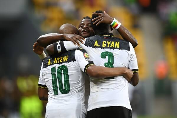 Ghana's forward Andre Ayew (L) celebrates with Ghana's midfielder Mubarak Wakaso and Ghana's forward Asamoah Gyan (R) after scoring a goal during the 2017 Africa Cup of Nations group D football match between Ghana and Uganda in Port-Gentil on January 17, 2017. / AFP / Justin TALLIS  (Jan. 16, 2017 - Source: AFP)