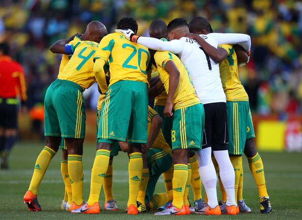 The South Africa team form a huddle prior to the 2010 FIFA World Cup South Africa Group A match between France and South Africa at the Free State Stadium on June 22, 2010 in Mangaung/Bloemfontein, South Africa.  (June 21, 2010 - Source: Michael Steele/Getty Images Europe)