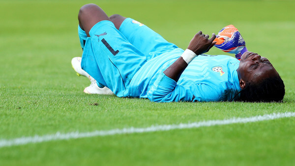 Patricia Mantey of Ghana lies injured on the pitch during the women's international friendly match between Germnay and Ghana at Benteler Arena on July 22, 2016 in Paderborn, Germany.  (July 21, 2016 - Source: Lars Baron/Bongarts)