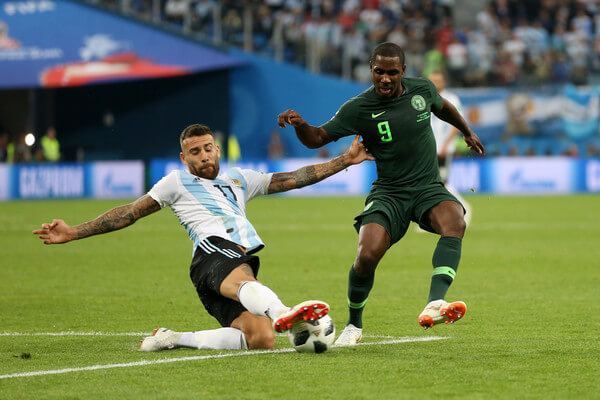 Nicolas Otamendi of Argentina slides in to tackle Odion Ighalo of Nigeria during the 2018 FIFA World Cup Russia group D match between Nigeria and Argentina at Saint Petersburg Stadium on June 26, 2018 in Saint Petersburg, Russia.  (June 25, 2018 - Source: Gabriel Rossi/Getty Images Europe)