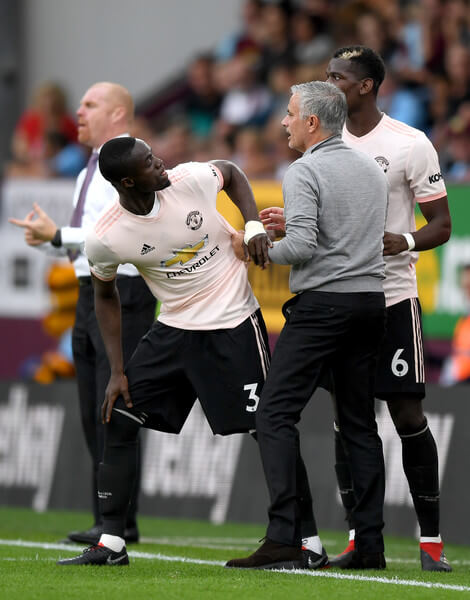 Jose Mourinho, Manager of Manchester United in discussion with Eric Bailly of Manchester United during the Premier League match between Burnley FC and Manchester United at Turf Moor on September 2, 2018 in Burnley, United Kingdom.  (Sept. 1, 2018 - Source: Shaun Botterill/Getty Images Europe)