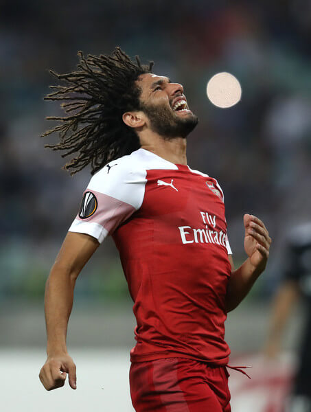 Mohamed Elneny of Arsenal is challenged by Vyacheslav Sharpar of Vorskla Poltava during the UEFA Europa League Group E match between Arsenal and Vorskla Poltava at Emirates Stadium on September 20, 2018 in London, United Kingdom.  (Sept. 19, 2018 - Source: Henry Browne/Getty Images Europe)