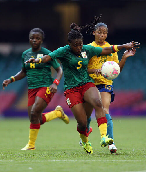 Augustine Ejangue of Cameroon battles with Barbara of Brazil during the Women's Football first round Group E Match of the London 2012 Olympic Games between Cameroon and Brazil at Millennium Stadium on July 25, 2012 in Cardiff, Wales.  (July 24, 2012 - Source: Julian Finney/Getty Images Europe)