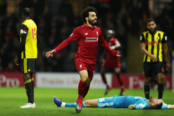 Mohamed Salah of Liverpool celebrates after scoring his team's first goal during the Premier League match between Watford FC and Liverpool FC at Vicarage Road on November 24, 2018 in Watford, United Kingdom.  (Nov. 23, 2018 - Source: Richard Heathcote/Getty Images Europe)