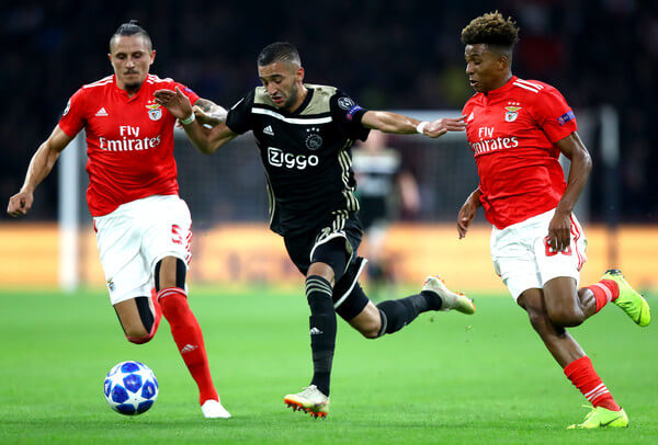 Hakim Ziyech of Ajax is challenged by Ljubomir Fejsa of Benfica (L) and Gedson of Benfica during the Group E match of the UEFA Champions League between Ajax and SL Benfica at Johan Cruyff Arena on October 23, 2018 in Amsterdam, Netherlands.  (Oct. 22, 2018 - Source: Dean Mouhtaropoulos/Getty Images Europe)