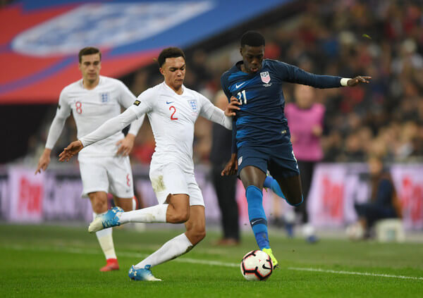 Timothy Weah of the United States is challenged by Trent Alexander-Arnold of England during the International Friendly match between England and United States at Wembley Stadium on November 15, 2018 in London, United Kingdom.  (Nov. 14, 2018 - Source: Shaun Botterill/Getty Images Europe)