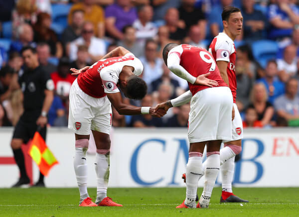 Alexandre Lacazette of Arsenal (9) celebrates with Pierre-Emerick Aubameyang as he scores his team's third goal during the Premier League match between Cardiff City and Arsenal FC at Cardiff City Stadium on September 2, 2018 in Cardiff, United Kingdom.  (Sept. 1, 2018 - Source: Catherine Ivill/Getty Images Europe)