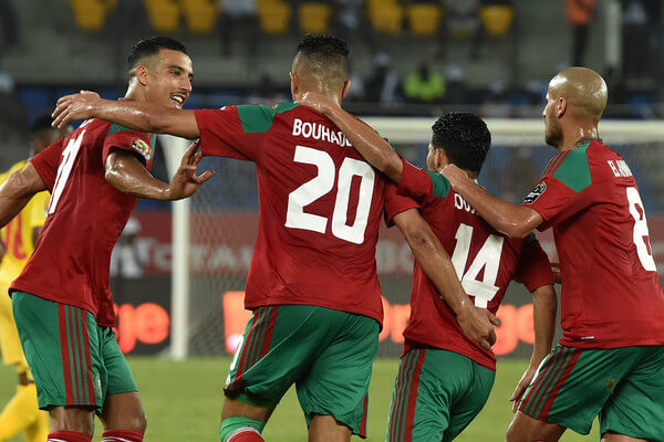 Morocco's forward Aziz Bouhaddouz (2nd-L) celebrates with teammates after scoring a goal during the 2017 Africa Cup of Nations group C football match between Morocco and Togo in Oyem on January 20, 2017. / AFP / ISSOUF SANOGO  (Jan. 19, 2017 - Source: AFP)