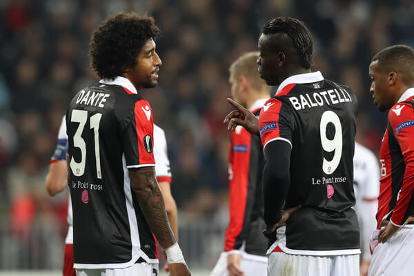 "Nice's Brazilian defender Dante (L) speaks to Nice's Italian forward Mario Balotelli (R) during the UEFA Europa League football match between OGC Nice vs SV Zulte Waregem on November 23, 2017 at the ""Allianz Riviera Stadium"" in Nice, southeastern France. / AFP PHOTO / VALERY HACHE  (Nov. 22, 2017 - Source: AFP)"