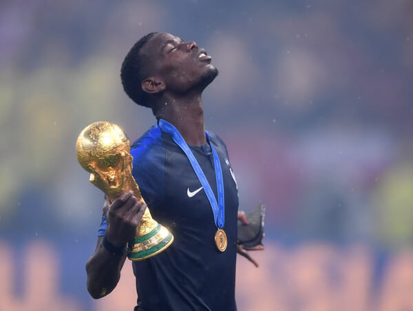 Paul Pogba of France celebrates with the World Cup Trophy following the 2018 FIFA World Cup Russia Final between France and Croatia at Luzhniki Stadium on July 15, 2018 in Moscow, Russia.  (July 14, 2018 - Source: Laurence Griffiths/Getty Images Europe)