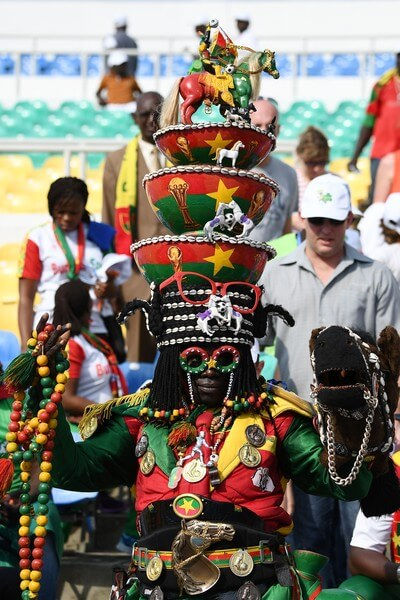 A Burkina Faso supporter poses ahead of the 2017 Africa Cup of Nations quarter-final football match between Burkina Faso and Tunisia at the Stade de l'Amitie Sino-Gabonaise in Libreville on January 28, 2017. / AFP / GABRIEL BOUYS  (Jan. 27, 2017 - Source: AFP)