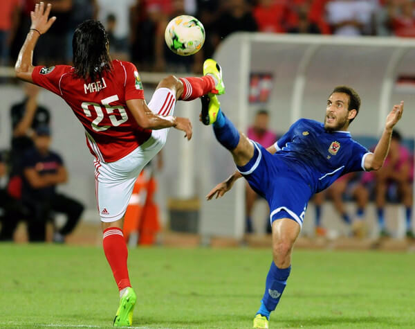 Sahel's striker Amro Marai (L) vies for the ball with Ahly's Hisham Mohamed (R) during the CAF Champions League semi-final football match between Etoile Sahel vs Al-Ahly at the Olympic Stadium in Sousse on October 1, 2017. / AFP PHOTO / SALAH HABIBI  (Sept. 30, 2017 - Source: AFP)