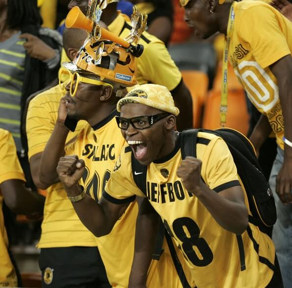 Chiefs fans celebrate as their team scores a goal during the Absa Premiership match between Kaizer Chiefs and Vasco da Gama at FNB Stadium on November 27, 2010 in Soweto, South Africa  (Nov. 26, 2010 - Source: Gallo Images/Getty Images AsiaPac)