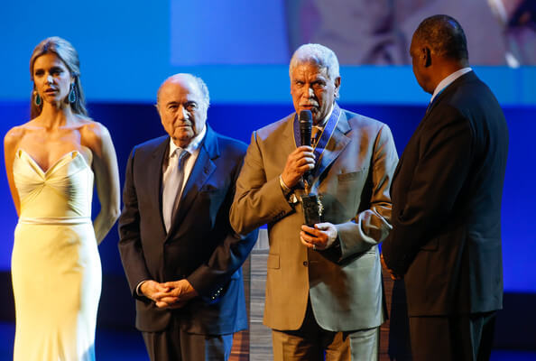Hassan Shehata of Egypt speaks after receiving the FIFA Order of Merit from FIFA President Joseph Blatter (2nd L) during the opening ceremony of the 64th FIFA Congress at the Expocenter Transamerica on June 10, 2014 in Sao Paulo, Brazil.  (June 9, 2014 - Source: Alexandre Schneider/Getty Images South America)