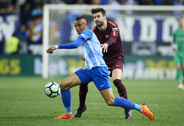 Gerard Pique of FC Barcelona duels for the ball with Youssef En-Nesyri of Malaga during the La Liga match between Malaga and Barcelona at Estadio La Rosaleda on March 10, 2018 in Malaga, spain.  (March 9, 2018 - Source: Aitor Alcalde/Getty Images Europe)