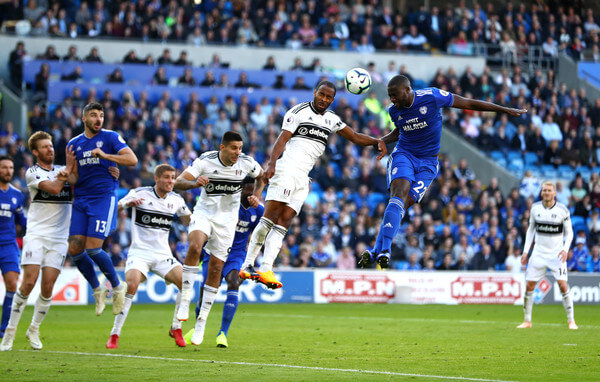 Sol Bamba of Cardiff City wins a header over Denis Odoi of Fulham during the Premier League match between Cardiff City and Fulham FC at Cardiff City Stadium on October 20, 2018 in Cardiff, United Kingdom.  (Oct. 19, 2018 - Source: Michael Steele/Getty Images Europe)