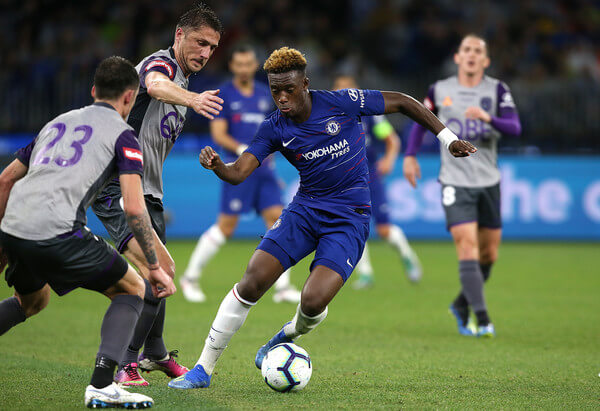 Callum Hudson-Odoi of Chelsea controls the ball against Dino Djulbic and Scott Neville of the Glory during the international friendly between Chelsea FC and Perth Glory at Optus Stadium on July 23, 2018 in Perth, Australia.  (July 22, 2018 - Source: Paul Kane/Getty Images AsiaPac)