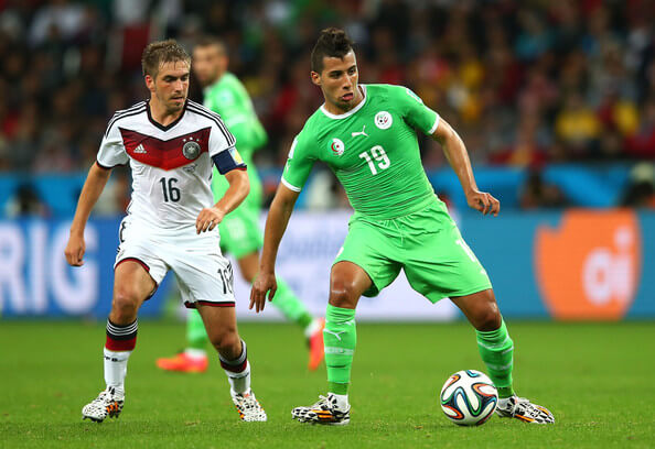 Saphir Taider of Algeria controls the ball against Philipp Lahm of Germany during the 2014 FIFA World Cup Brazil Round of 16 match between Germany and Algeria at Estadio Beira-Rio on June 30, 2014 in Porto Alegre, Brazil.  (June 29, 2014 - Source: Julian Finney/Getty Images South America)