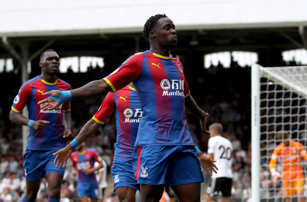 Jeffrey Schlupp of Crystal Palace celebrates after scoring his team's first goal during the Premier League match between Fulham FC and Crystal Palace at Craven Cottage on August 11, 2018 in London, United Kingdom.  (Aug. 10, 2018 - Source: Christopher Lee/Getty Images Europe)