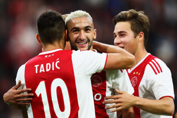 Dusan Tadic of Ajax celebrates scoring a goal with Hakim Ziyech during the Eredivisie match between Ajax and Emmen at Johan Cruyff Arena on August 25, 2018 in Amsterdam, Netherlands.  (Aug. 24, 2018 - Source: Dean Mouhtaropoulos/Getty Images Europe)